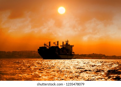 Container ship anchored in Algeciras bay during the sunset.