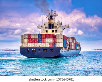 A container ship arriving to industial port on smooth sea.
