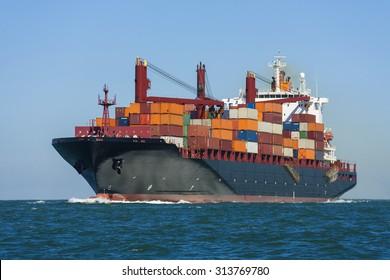 Container ship or boat sailing at sea