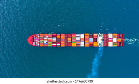 Container ship carrying container for business freight shipping import and export transportation logistic, Aerial view container ship arriving in commercial port, Container loading cargo freight ship.
