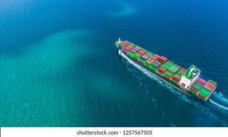 Container ship carrying container for import and export, Aerial view business logistic and freight transportation by container ship in open sea.