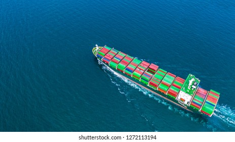 Container ship carrying container for import and export, business logistic and freight transportation by ship in open sea.