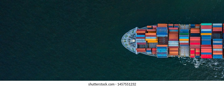 Container ship carrying container for import and export, business logistic and transportation by container ship in open sea, Aerial view container cargo ship with copy space for design banner web - Shutterstock ID 1457551232