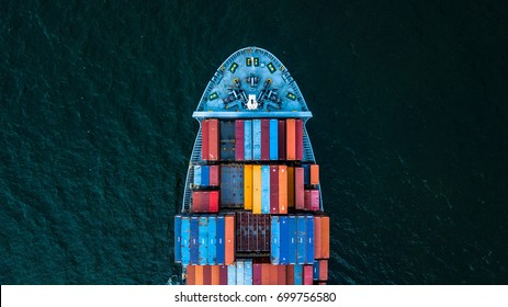 Container ship carrying container for import and export, business logistic and transportation by ship in open sea, Aerial view container ship.