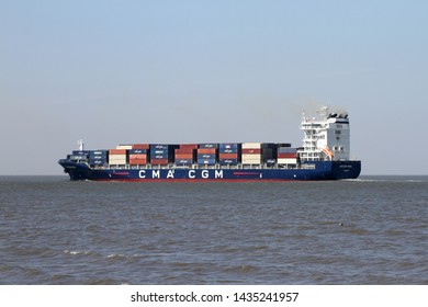 The container ship CMA CGM Neva passes on 17 April 2019 Cuxhaven on the Elbe and continues towards the North Sea.