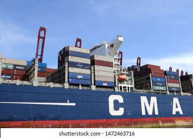 The container ship CMA CGM Zheng He leaves Hamburg harbor on May 11, 2019.