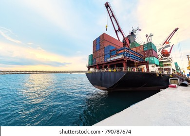 container ship commercial vessel alongside in port for loading and discharging containers services in maritime transports in World wide logistics