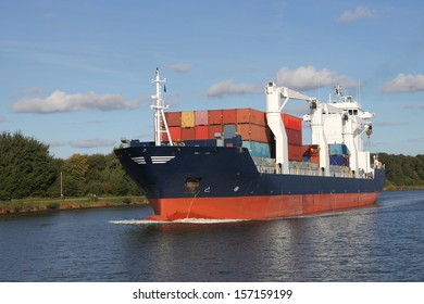 container ship with cranes on Kiel Canal, Germany