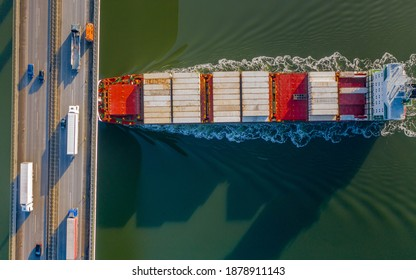 Container ship crosses the Rader Hochbrücke in the Kiel Canal.