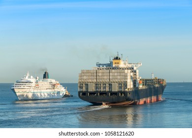 Container ship and cruise ship on the river Weser in Bremerhaven, Germany