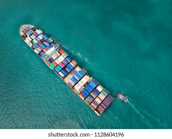 Container ship in export and import business and logistics in the ocean. Water transport International. Aerial view
