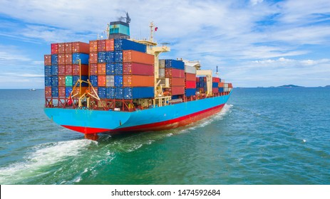Container ship leaving the industrial port, Import and export business logistic and transportation of international by container ship in the open sea.