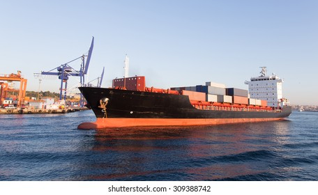 A container ship leaving from the port