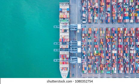 Container ship loading at port with crane, container ship carrying container import and export business logistic and transportation, Aerial top view.