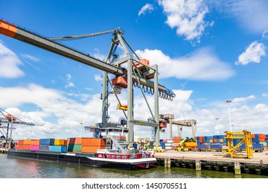Container ship and logistics. Shipping cargo loading by crane. Water transport, export and import business. International commercial harbor of Rotterdam Netherlands, sunny summer day