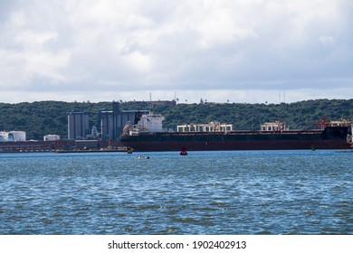 Container ship moored in harbour below bluff at Durban