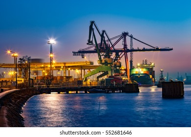 Container ship at night in Port of Gdansk, Poland.
