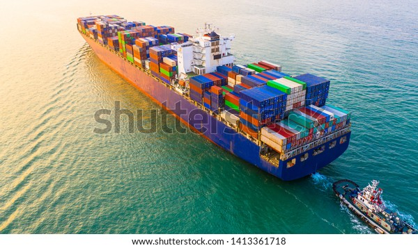 Container ship sailing through the ocean, Business logistics and transportation of International container ship in the ocean freight transportation, Aerial view Container loading cargo freight ship.