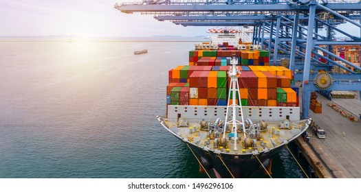 Container ship terminal, Unloading and quay crane of container ship at industrial port with shipping container vessel, Maritime cargo freight ship import export business logistic transportation.