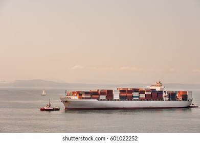 Container ship tugged across Puget Sound to Seattle port