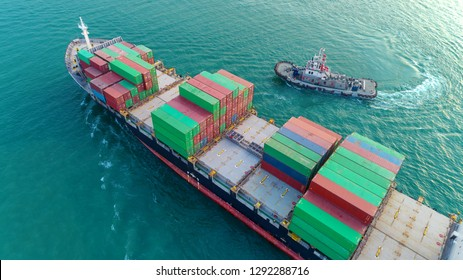 Container ship and Tuk boat going to sea port for logistics shipping , import export or transportation.