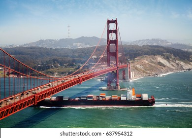 container ship under golden gate bridge in san francisco