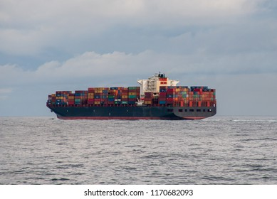 Container ship,  well loaded, at sea underway in the North Atlantic.