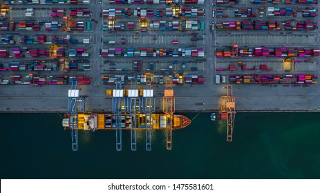 Container ship working at night, Business import export logistic and transportation of International by container ship in the open sea, Aerial view container ship loading and unloading at night.