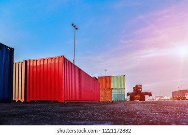 Container in shipping yard of dockyard  stacked  for transport import, export and logistic industrial concept on blue sky background Thailand