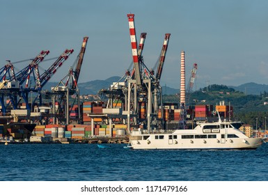 Container ships, containers and cranes in the harbor of La Spezia, Liguria, Italy, Europe