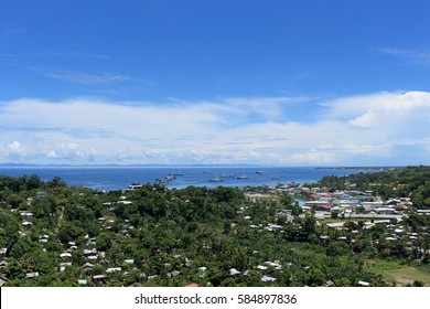 Container ships in the harbor of Honiara, Solomon Islands