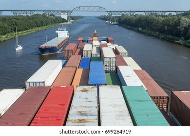 Container ships on Kiel Canal, Germany
