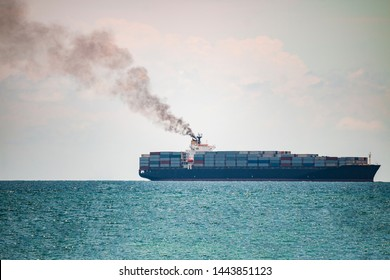 Container ships in the sea have a lot of black smoke, Green earth concept.
