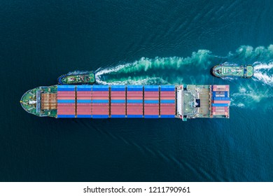 Container ships transporting large cargo and tugboat to import and export goods internationally around the world, including Asia Pacific and Europe, by sea, Aerial view with drone camera photography - Shutterstock ID 1211790961