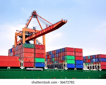 Container stacks on board under crane bridge
