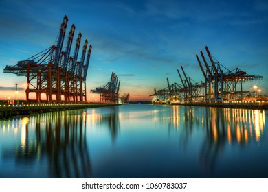 Container terminal Burchardkai in the port of Hamburg during blue hour