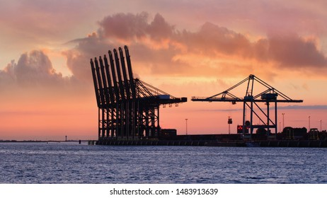 Container terminal at red colored sunset in Port of Antwerp, Belgium