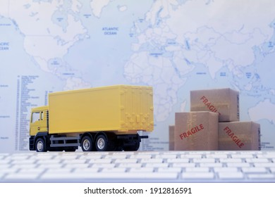 Container truck loading cargo shipping container box with worldmap background use as online tracking technology of worldwide logistic, shipping, import and export concept.