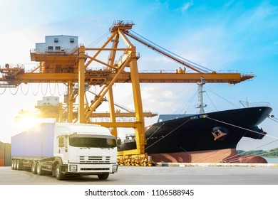 Container truck on road with container ship being unloaded in the commercial harbor delivery cargo transportation concept
