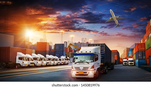 Container truck in ship port for business Logistics and transportation of Container Cargo ship and Cargo plane with working crane bridge in shipyard at sunrise, logistic import export and transport
