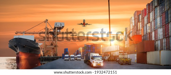Container truck in ship port for business Logistics and transportation of Container Cargo ship and Cargo plane with working crane bridge in shipyard at sunrise, logistic import export Concept