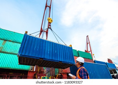 container unit being lifting loading by the ship's crane from the trailer delivery to the port terminal, the services of logistics and transport shipment to worldwide global