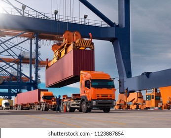 The container vessel during loading at an industrial port by port crane.