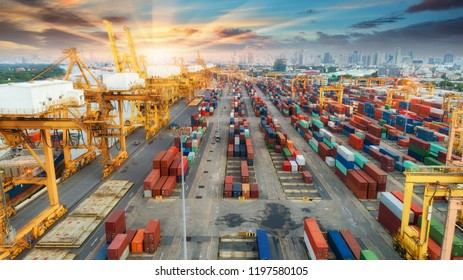 Container warehouse waiting for delivery containers shipment and working crane bridge in shipyard at sunrise. Suitable use for transport or import export to global logistics concept.