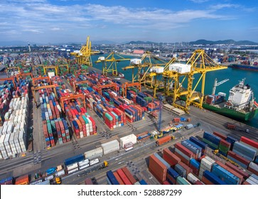 container,container ship in import export and business logistic.By crane , Trade Port , Shipping.Tugboat assisting cargo to harbor.Aerial view.Water transport.International.Shell Marine.transaction.