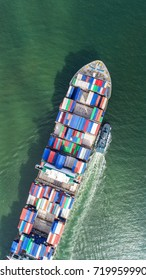 container,container ship in import export and business logistic,By crane,Trade Port , Shipping,cargo to harbor.Aerial view,Water transport,International,Shell Marine,transportation,logistic,trade,port - Shutterstock ID 719959990