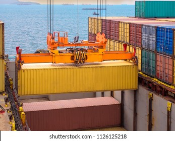 Containers are discharging from vessel by port crane at port of Thailand, Closeup crane to pick up container onboard.