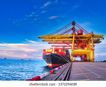 Containers are discharging from vessel by truck in port of Thailand