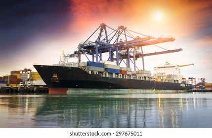 Containers loading by crane at dark , Trade Port , Shipping