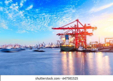 Containers loading by crane in the morning,trade port,shipping
